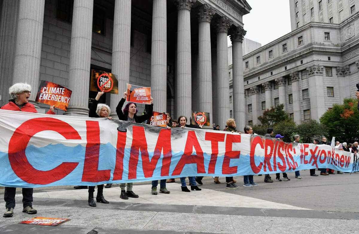 Climate activists protest on the first day of the ExxonMobil trial outside the New York State Supreme Court building on October 22, 2019 in New York City.
