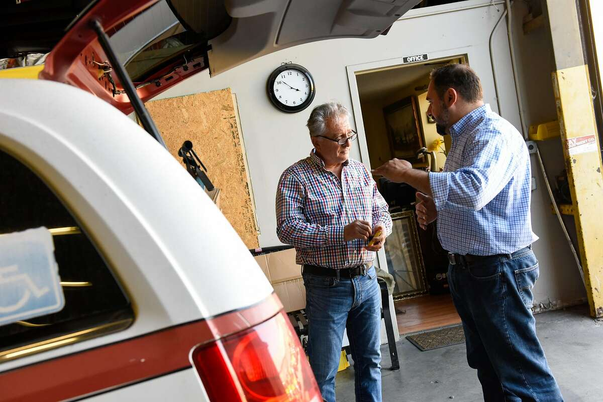 Jam Khajvanei, mechanic shop manager, discusses changes needed for a handicap taxi cab with Chris Sweis, CEO, at Yellow Cab headquarters in San Francisco on October 23, 2019 in San Francisco, Calif.