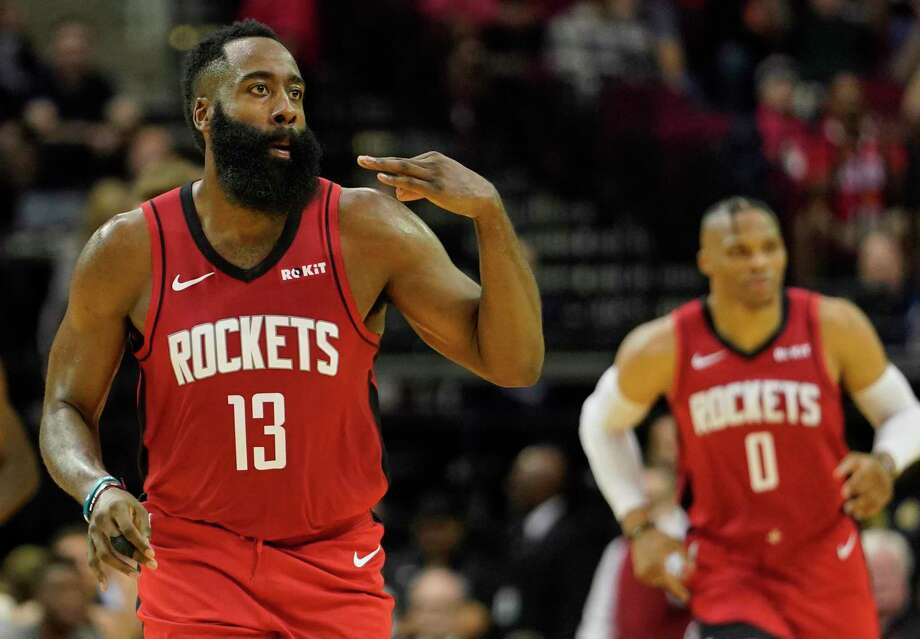 Houston Rockets James Harden signals his three pointer scored against the Milwaukee Bucks during first half of NBA game at Toyota Center Thursday, Oct. 24, 2019, in Houston. Photo: Melissa Phillip, Houston Chronicle / Staff Photographer / © 2019 Houston Chronicle