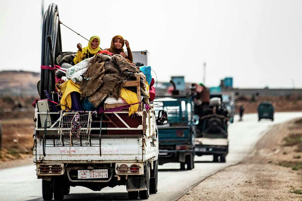 Syrian Kurdish and Arab families flee the countryside near the border between Syria and Turkey. A reader is deeply disappointed by the decision to pull U.S. troops from the region and fears the prospect of genocide.