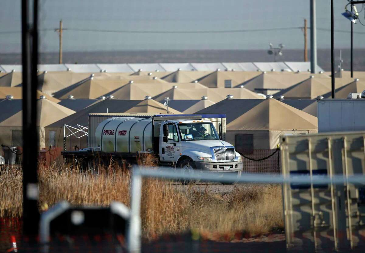 A potable water truck is seen among tents inside the Tornillo detention camp for migrant teens in Tornillo, Texas, Dec. 13, 2018. A reader agrees for-profit detention camps encourage continued family separation.