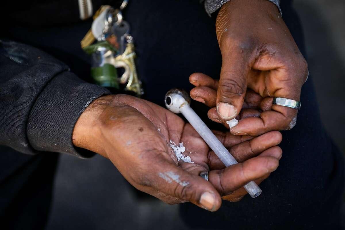 Rockey prepares to use crystal meth on Ellis Street in San Francisco, California, on Monday, Oct. 14, 2019.