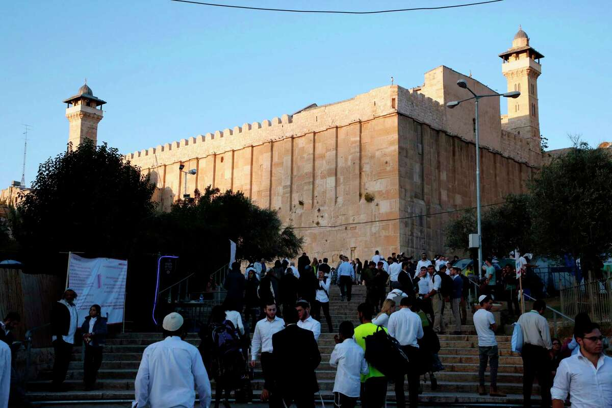 Jewish worshippers gather near their tents outside the Tomb of the Patriarch, or the Ibrahimi mosque, in the West Bank town of Hebron on November 10, 2017, during an annual pilgrimage organised by Israel's settler movement on the occasion of the Chayei Sarah (Life of Sarah) commemorations. / AFP PHOTO / HAZEM BADERHAZEM BADER/AFP/Getty Images