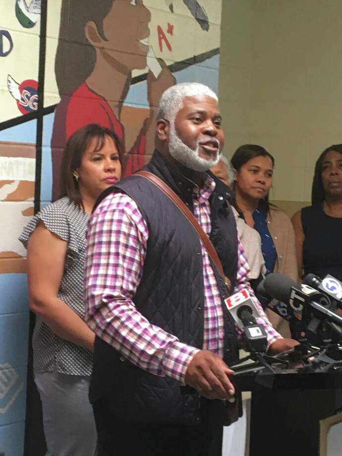 The Boys and Girls Club of New Haven will remain open and will continue to serve hundreds of city boys and girls as a result of a deal roughed-out this week, Mayor Toni Harp announced Friday afternoon. Here, Hill-area AlderRon Hurt, D-3, speaks. Photo: Mark Zaretsky / Hearst Connecticut Media