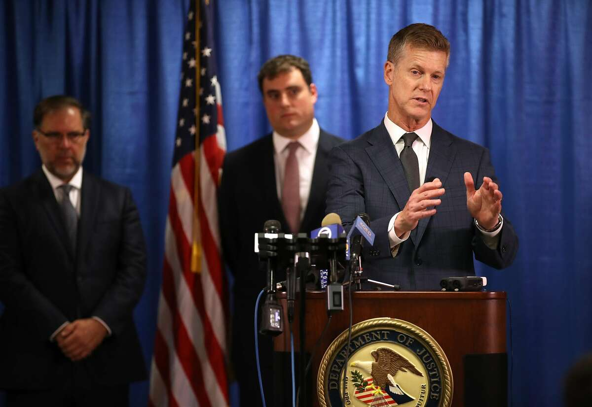 SAN FRANCISCO, CALIFORNIA - SEPTEMBER 30: United States attorney David L. Anderson (R) speaks during a news conference on September 30, 2019 in San Francisco, California. The U.S. attorney's office of the Northern District of California announced a criminal complaint against Xuehua Peng, also known as Edward Peng, for acting as an illegal foreign agent that allegedly delivered classified U.S. national security information to the government of the People's Republic of China's Ministry of State Security. (Photo by Justin Sullivan/Getty Images)