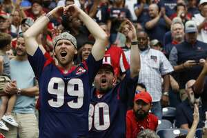 Houston Texans fans cheer during an NFL football game against the Atlanta Falcons at NRG Stadium on Sunday, Oct. 6, 2019, in Houston.
