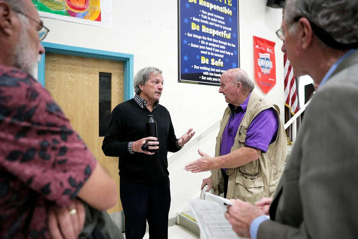 Congressman Mark DeSaulnier speaks to his constituent Davie Gordon, right, during town hall meeting in Pittsburg, Calif., on Tuesday, October 1, 2019.