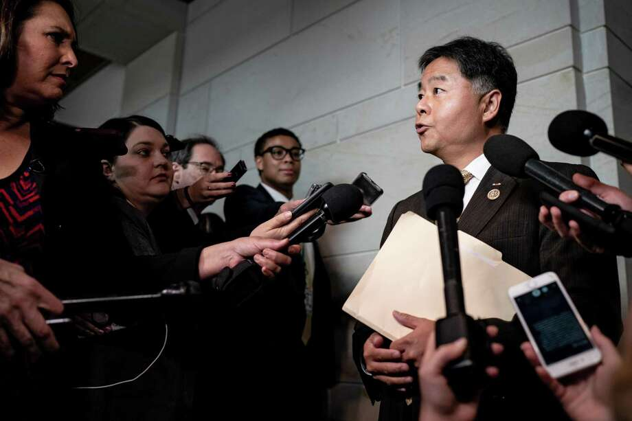 "Rep. Ted Lieu (D-Calif.) talks to reporters outside the secure room where impeachment investigation interviews are taking place on Capitol Hill in Washington on Wednesday, Oct. 23, 2019. About two dozen House Republicans, chanting ""Let us in! Let us in!"" tried to storm the secure room where a Defense Department official arrived Wednesday morning to testify in the impeachment inquiry, refusing to leave even after they were turned back by Representative Adam B. Schiff, Democrat of California and the chairman of the House Intelligence Committee that was leading the deposition. (Erin Schaff/The New York Times) Photo: ERIN SCHAFF, STF / NYT / NYTNS"