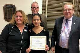 Shelton High School sophomore Ria Dalvi with, left to right, Michele Piccolo, school Superintendent Chris Clouet and Board of Education Chairman Mark Holden.