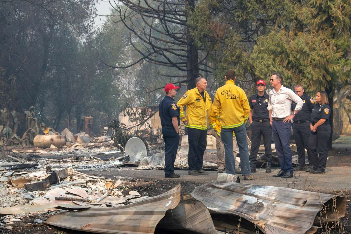 Gov. Gavin Newsom tours a home destroyed in the Kincade Fire, with Cal Fire officials, Friday, Oct. 25, 2019, in Geyserville, Calif.