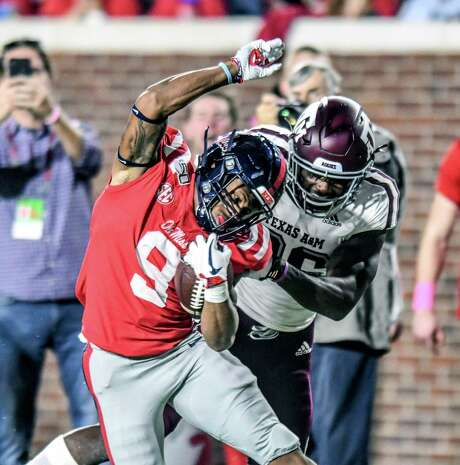 Mississippi's Jerrion Ealy slips away from Texas A&M's Demani Richardson on a 69-yard scoring run, one of five big plays the Aggies gave up last week.