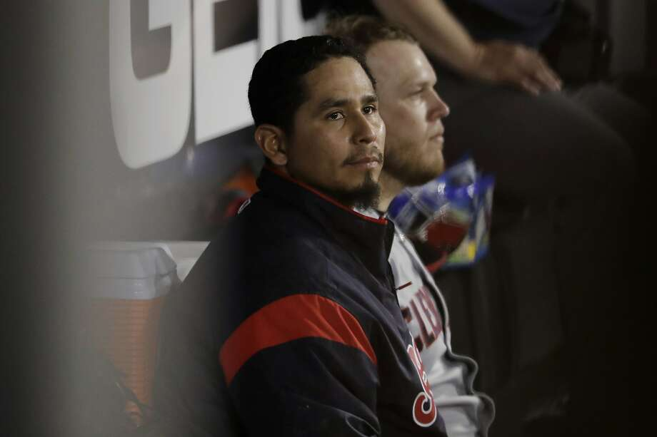 Indians pitcher Carlos Carrasco has won looks to the field from the dugout Photo: Nam Y. Huh / Associated Press