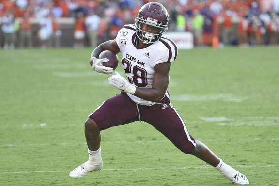 Texas A&M's Isaiah Spiller runs after making a catch during the first half of an NCAA college football game against Clemson Saturday, Sept. 7, 2019, in Clemson, S.C. Clemson won 24-10. (AP Photo/Richard Shiro)