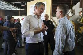 California Governor Gavin Newsom, left, talks with California State Senator Mike McGuire following a press conference at the CAL FIRE Healdsburg Station, near Geyserville, Calif.,  Friday, Oct. 25, 2019. (Christopher Chung/The Press Democrat via AP)