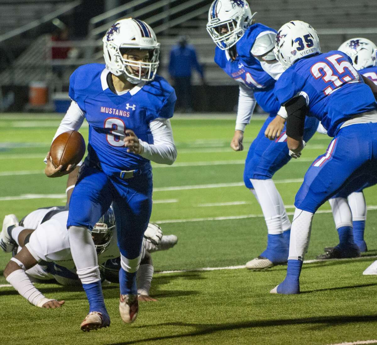 Midland Christian's Ryver Rodriguez looks for room to run after getting past FW Nolan defenders 10/25/19 at Gordon Awtry Field. Tim Fischer/Reporter-Telegram