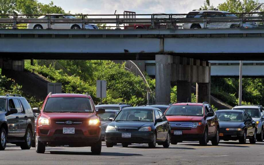 Traffic is backed up waiting to get onto the Northway, Albany Shaker and Wolf roads at rush hour Friday afternoon August 6, 2010.  (John Carl D'Annibale / Times Union) Photo: John Carl D'Annibale / 00009783A
