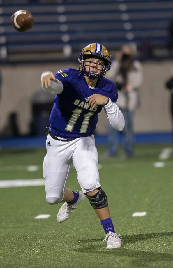 Midland High's Landry Walls (11) throws the ball Friday, Oct. 25, 2019 at Grande Communications Stadium. Photo: Jacy Lewis/Reporter-Telegram