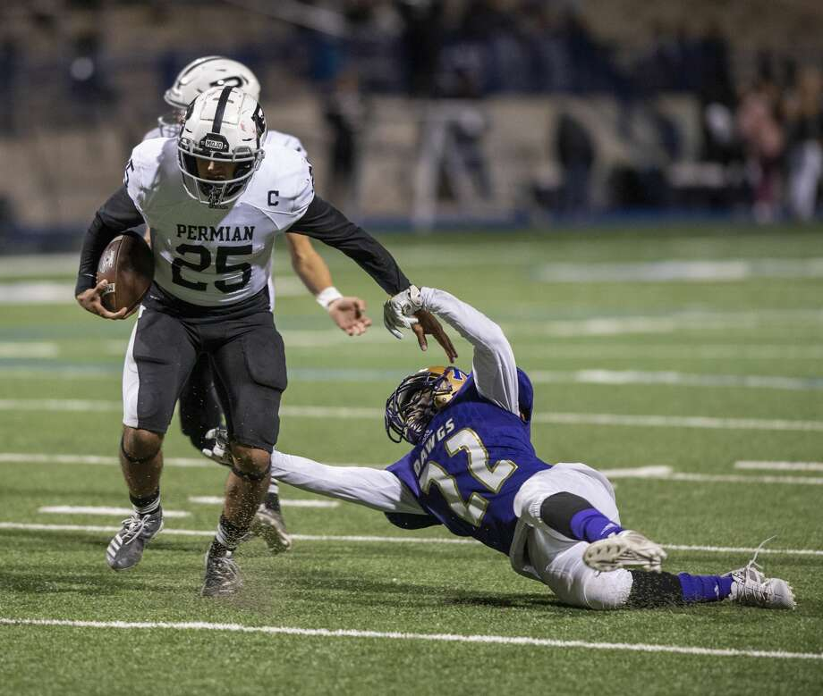 Midland High's Martin Flores (22) attempts to tackle Odessa Permian's Easton Hernandez (25) on Friday, Oct. 25, 2019 at Grande Communications Stadium. Photo: Jacy Lewis/Reporter-Telegram