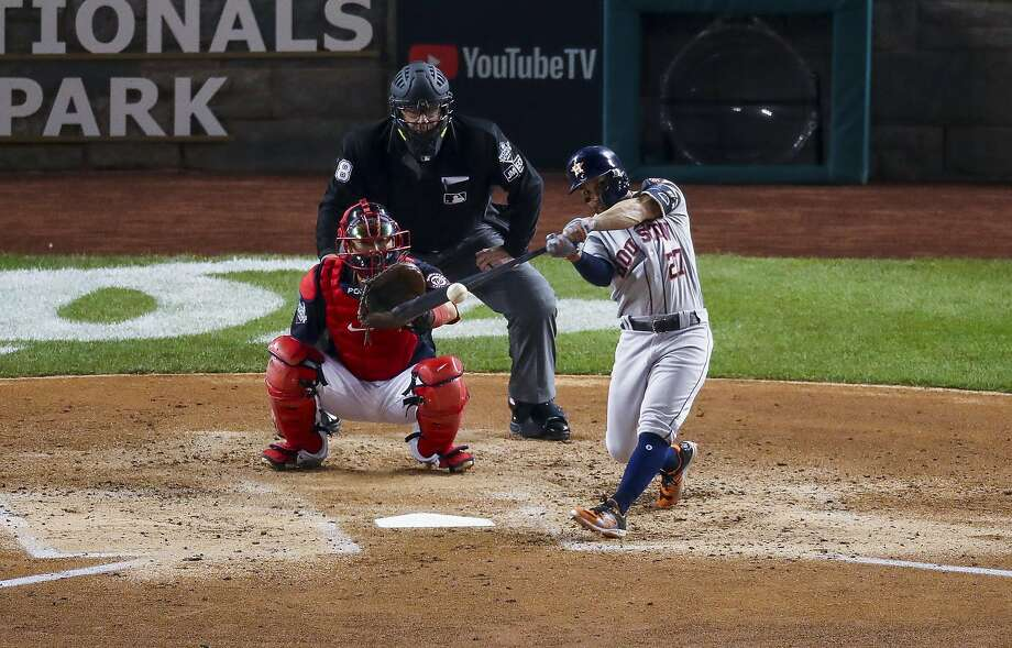 Houston Astros second baseman Jose Altuve (27) hits a double during the third inning of Game 3 of the World Series at Nationals Park in Washington, D.C. on Friday, Oct. 25, 2019. Photo: Godofredo A. Vásquez, Staff Photographer