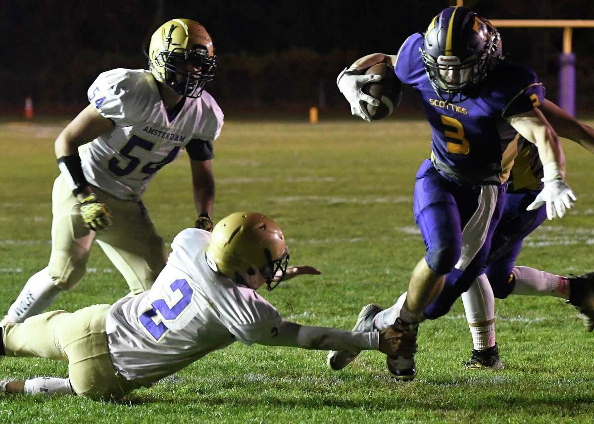 Amsterdam defensive back Josiah Newborn attempts to tackle Ballston Spa half back James Prastio Jr. during their Class A quarterfinal game on Friday, Oct. 25, 2019, in Ballston Spa, N.Y. (Jenn March, Special to the Times Union )