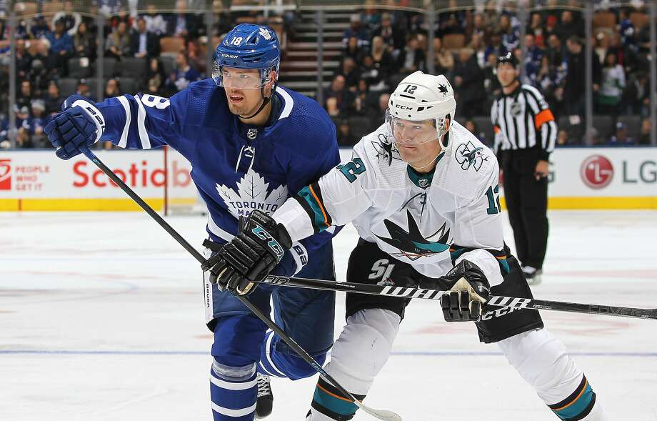 San Jose's Patrick Marleau grapples with Toronto's Andreas Johnsson during his 1,500th NHL game. Photo: Claus Andersen / Getty Images