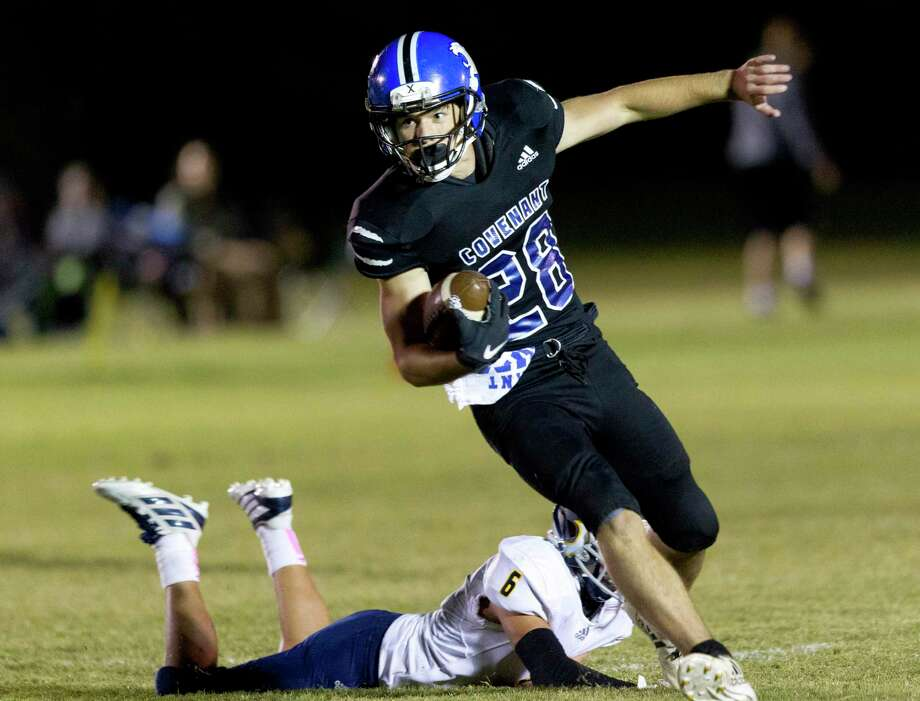 Covenant Christian tail back Wade Harper (28) runs past Allen Academy defensive back Kyle Dupont (6) during the first quarter of a TAPPS District 3-2A high school football game, Friday, Oct. 25, 2019, in Conroe. Photo: Jason Fochtman, Houston Chronicle / Staff Photographer / Houston Chronicle