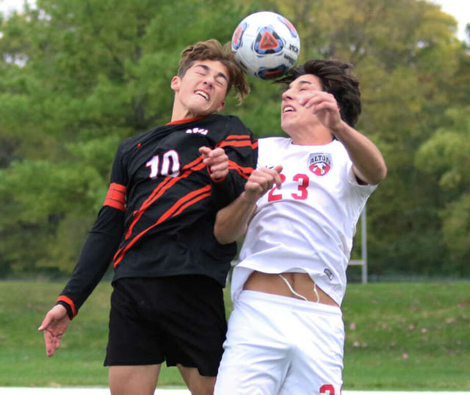 Alton's Justin Davison (right) and Edwardsville's Jakob Doyle vie for a headball near the Redbirds goal early in the Class 3A regional title match Friday in Edwardsville. Photo: Greg Shashack / The Telegraph