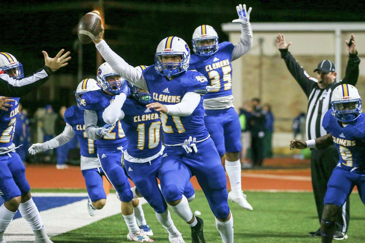 Clemens' Jackson Macias, center, celebrates his 64-yard touchdown on a fake punt in the first half in their District 26-6A high school football game with East Central Oct. 25, 2019, at Lehnhoff Stadium.