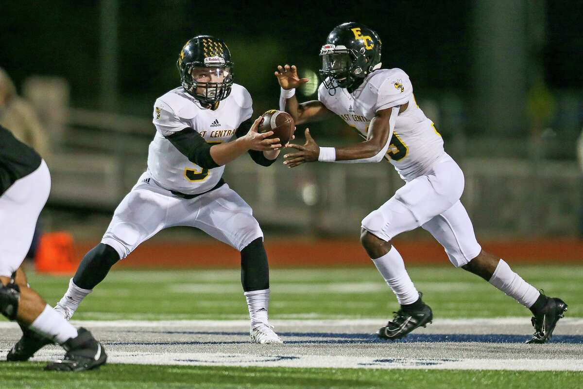 East Central quarterback Caden Bosanko hands off to Deangelo Rosemond in the first half in their District 26-6A high school football game with Clemens at Lehnhoff Stadium on Friday, Oct. 25, 2019.