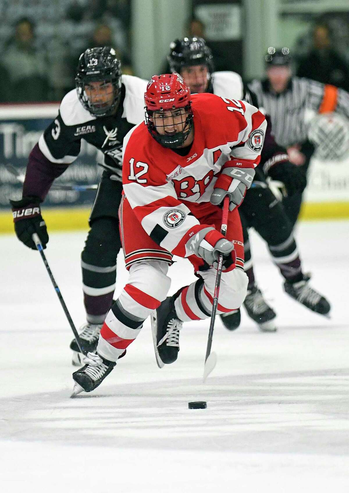 Rensselaer Polytechnic Institute forward Chase Zieky (12) moves the puck against Union during the second period of an NCAA hockey game Friday Oct. 25, 2019, in Schenectady, N.Y. (Hans Pennink / Special to the Times Union)