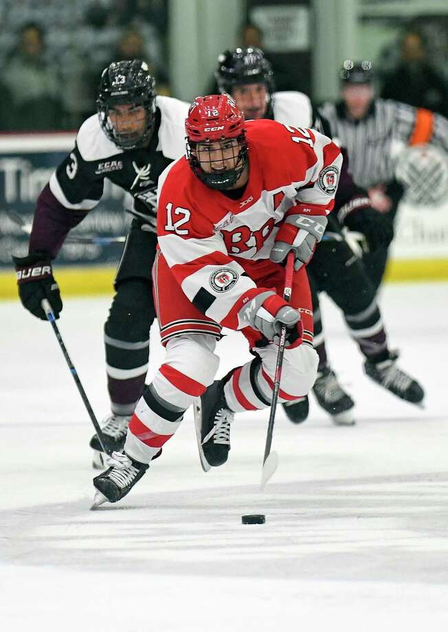 Rensselaer Polytechnic Institute forward Chase Zieky (12) moves the puck against Union during the second period of an NCAA hockey game Friday Oct. 25, 2019, in Schenectady, N.Y. (Hans Pennink / Special to the Times Union) Photo: Hans Pennink / Hans Pennink