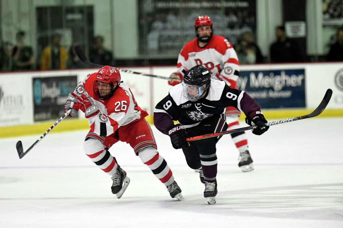 Rensselaer Polytechnic Institute forward Jake Marrello (26) and Union forward Blake Hayward (9) chase the puck during the second period of an NCAA hockey game Friday Oct. 25, 2019, in Schenectady, N.Y. (Hans Pennink / Special to the Times Union)