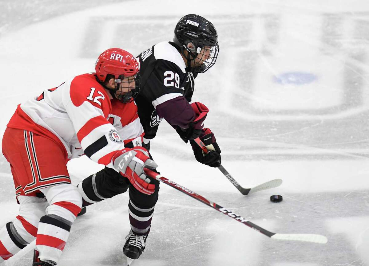 Union forward Sean Harrison (29) moves the puck past Rensselaer Polytechnic Institute forward Chase Zieky (12) during the first period of an NCAA hockey game Friday Oct. 25, 2019, in Schenectady, N.Y. (Hans Pennink / Special to the Times Union)