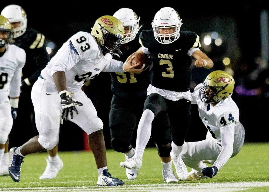 Conroe quarterback Christian Pack (3) runs past Klein Collins defensive linemen Zechariah Ivery (93) and linebacker Deandre Rucker (44) for a 61-yard touchdown during the second quarter of a District 15-6A high school football game at Buddy Moorhead Stadium, Friday, Oct. 25, 2019, in Conroe. Photo: Jason Fochtman, Houston Chronicle / Staff Photographer / Houston Chronicle