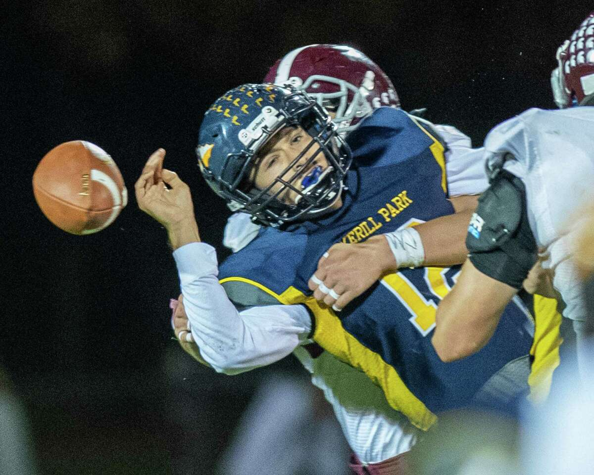 Averill Park quarterback Anthony Childrose fumbles the ball after getting hit by a Burnt Hills Ballston Lake defender during the Section II Class A quarterfinal football game at Averill Park High School on Friday, Oct. 25, 2019 (Jim Franco/Special to the Times Union.)