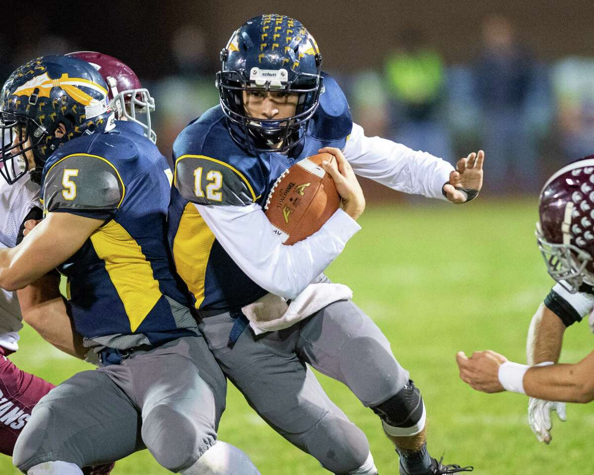 Averill Park quarterback Anthony Childrose hits a hole created by running back Dan McShane during the Section II Class A quarterfinal football game against Burnt Hills Ballston Lake at Averill Park High School on Friday, Oct. 25, 2019 (Jim Franco/Special to the Times Union.)