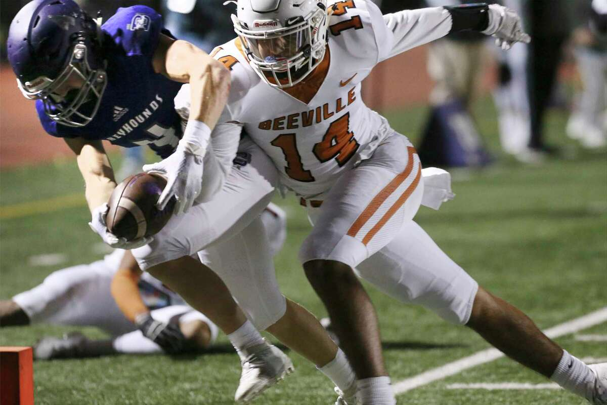 Boerne's Matt Michalec (04) makes the extra effort to score a touchdown against Beeville Jones' Victor Gonzales (14) during their football game in Boerne on Friday, Oct. 25, 2019. (Kin Man Hui/San Antonio Express-News)