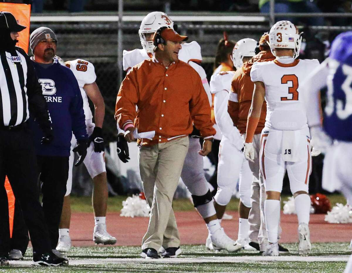 Beeville Jones' head coach Chris Soza (center) directs his team against Boerne during their football game in Boerne on Friday, Oct. 25, 2019. (Kin Man Hui/San Antonio Express-News)