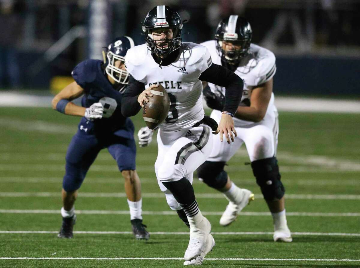 Knight quarterback Wyatt Begeal takes off running on a broken play in the first half as Smithson Valley hosts Steele at Smithson Valley High School on 25, 2019.