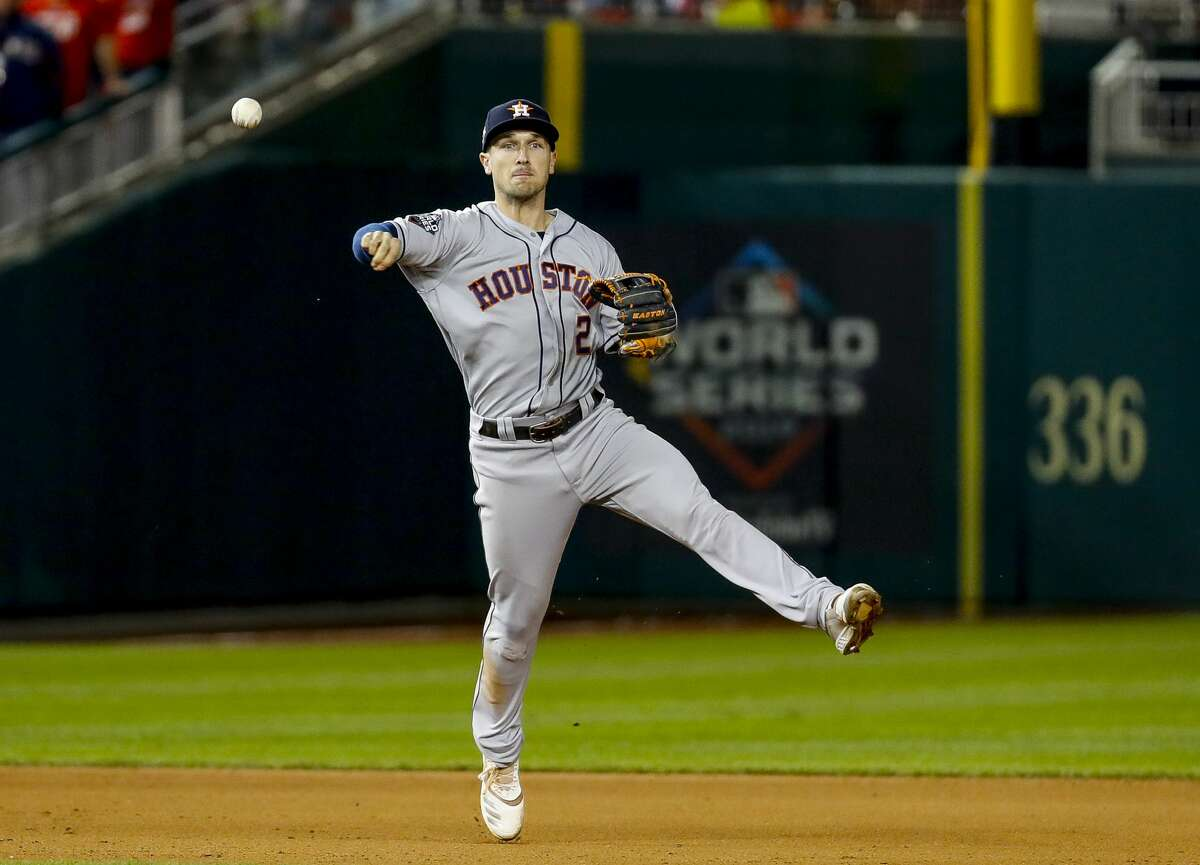 Houston Astros third baseman Alex Bregman (2) throws out Washington Nationals catcher Yan Gomes (10) to end the eighth inning of Game 3 of the World Series at Nationals Park in Washington, D.C. on Friday, Oct. 25, 2019.