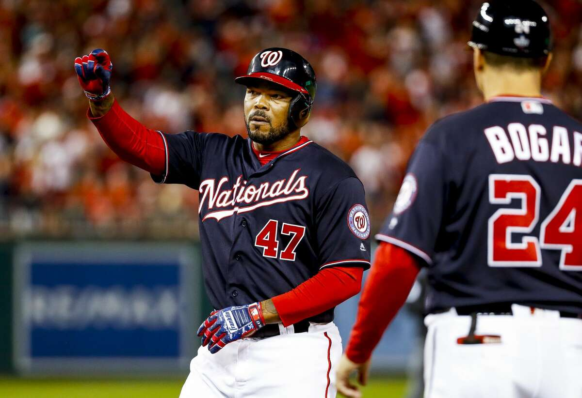 Washington Nationals designated hitter Howie Kendrick (47) celebrates his single to center field during the eighth inning of Game 3 of the World Series at Nationals Park in Washington, D.C. on Friday, Oct. 25, 2019.