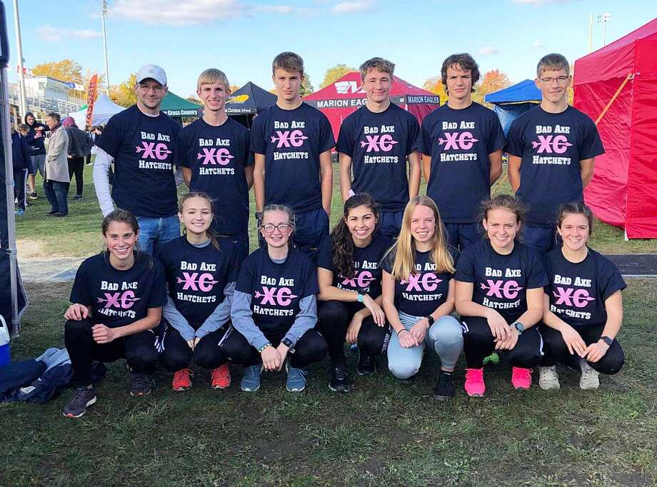 Members of the Bad Axe cross country squad teamed up with parents to support Abigail Rochefort, the wife of Bad Axe cross country head coach Nick Rochefort. The team wore the supportive breast cancer shirts for the Division 3 Regional meet on Friday, Oct. 25. Photo: Submitted Photo