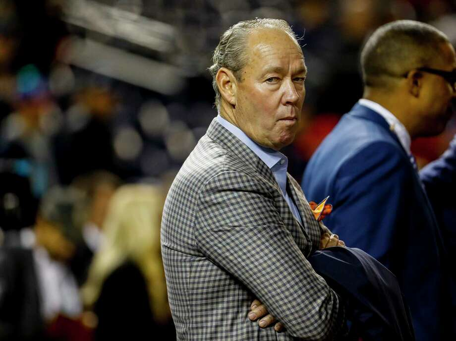 Astros owner Jim Crane, watching batting practice during the World Series, declined to answer questions on MLB's investigations into the team.