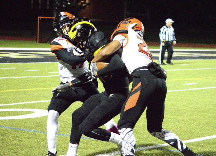 Edwardsville's Ethan Young (left) and Eric Epenessa, right, tackle a Vianney player during the second quarter of Friday's game at Vianney. Photo: Scott Marion/The Intelligencer