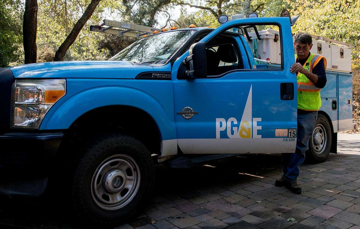 PG&E crew member Rick Bertel exits his truck to monitor a power meter while inspecting power lines for damage along Camellia Lane in Lafayette, Calif. Friday, Oct. 11, 2019.
