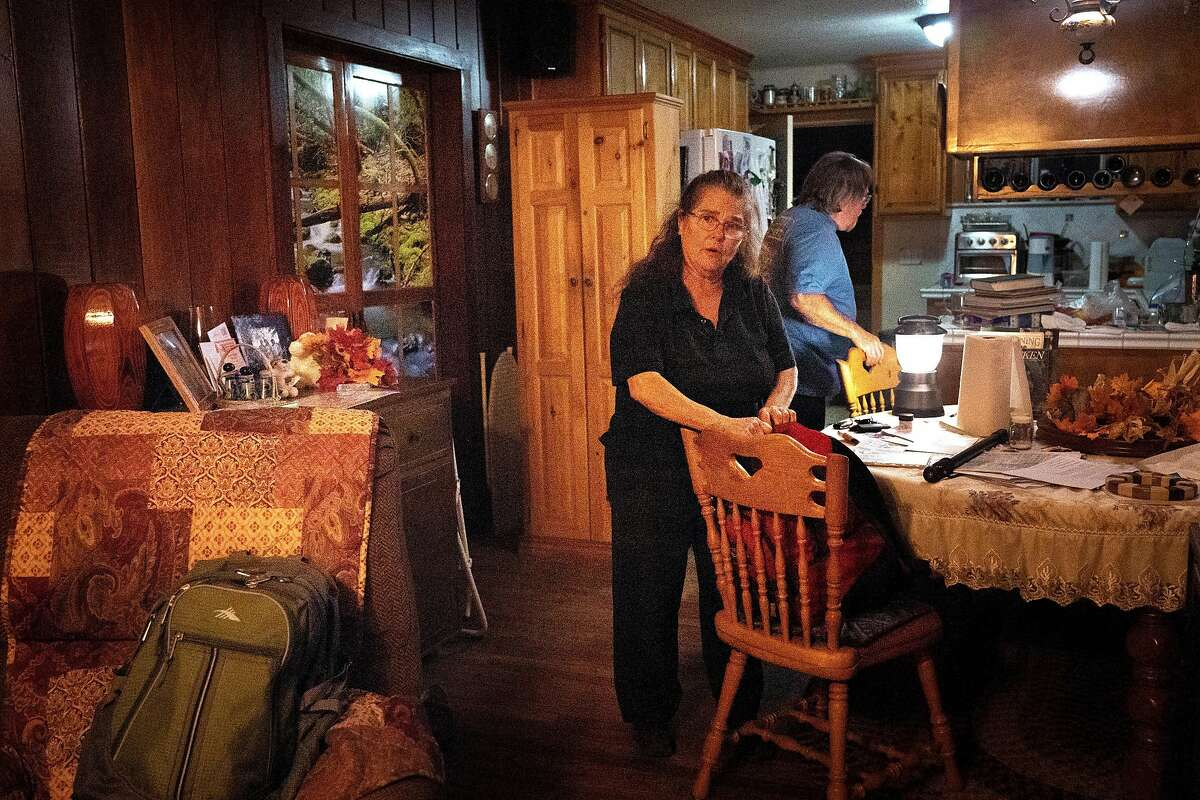 Roilene picks up last items before evacuating from her house with her husband Wolfgang on Saturday, Oct. 26, 2019, in Geyserville, Calif.