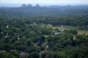The Connecticut Agricultural Experiment Station, downtown New Haven, and the Sound are the view from the top of the head at the newly re-opened Sleeping Giant State Park in Hamden on Sunday, June 23, 2019.