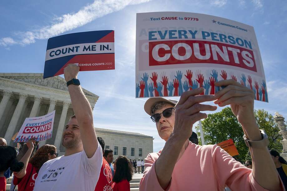 FILE - In this April 23, 2019, file photo, immigration activists rally outside the Supreme Court as the justices hear arguments over the Trump administration's plan to ask about citizenship on the 2020 Census, in Washington. Worried about internet trolls and foreign powers spreading false news, census officials are preparing to battle misinformation campaigns for the first time in the bureau's 230-year history. (AP Photo/J. Scott Applewhite, File) Photo: J. Scott Applewhite, Associated Press