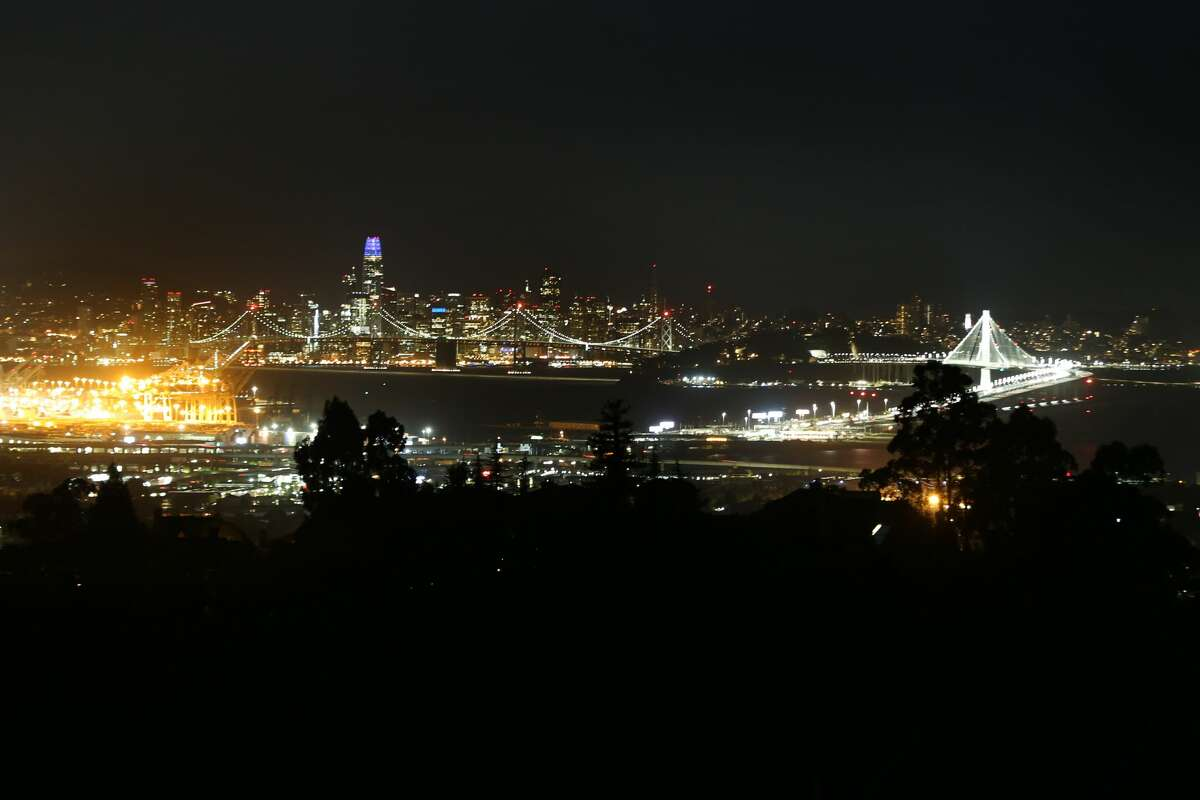 The city of San Francisco and the Bay Bridge are seen from the Oakland hills during the PG&E power outage on Oct. 10, 2019. More than 700,000 homes and businesses in the San Francisco Bay Area were affected by the power shutoff, according to PG&E.