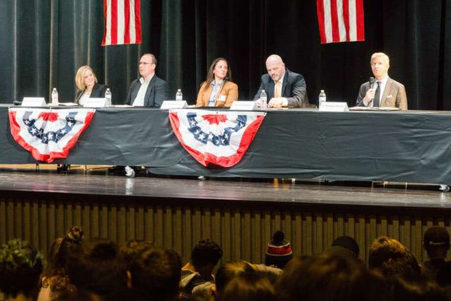 Board of Education candidates answer questions from Ridgefield High School seniors during the mock debate at the high school on Oct. 22. Photo: Contributed Photo